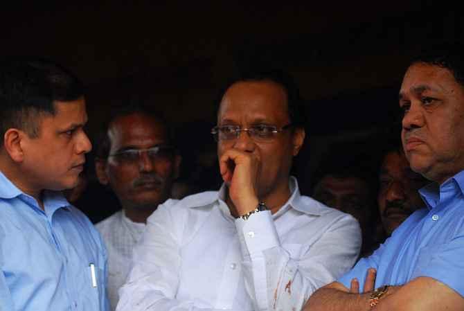 Maharashtra deputy CM Ajit Pawar at the site of the landslide