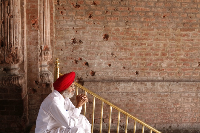 A Sikh devotee prays inside the Golden Temple complex.