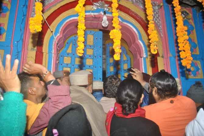 Devotees at the temple's entrance at the reopening.
