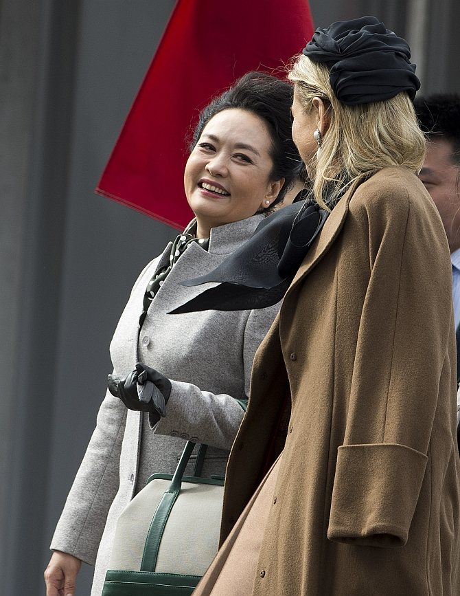 Peng Liyuan, the wife of China's President Xi Jinping, talks to Queen Maxima of the Netherlands