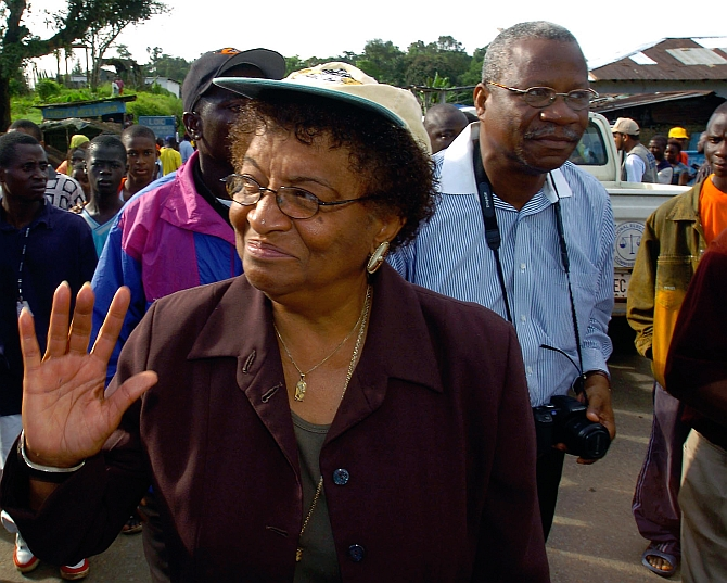 Ellen Johnson-Sirleaf waves to a well-wishers in Tubmanburg, Liberia