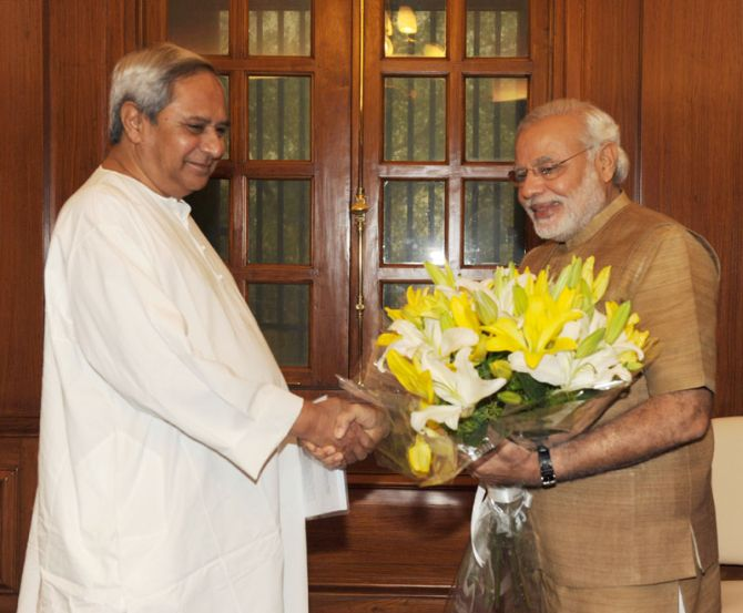 Odisha Chief Minister Naveen Patnaik greets Prime Minister Narendra Modi on June 2, 2014.