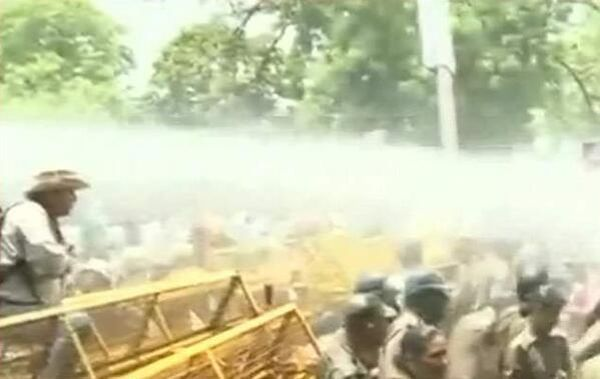The police used water cannons to disperse the angry crowd.