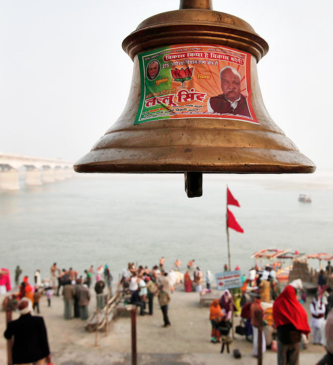 A temple bell pasted with a pamphlet the Bharatiya Janata Party is seen in Ayodhya