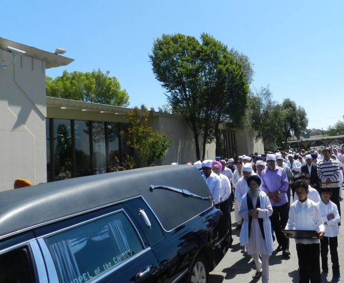 Members of the community attend the Anita Sidhu's funeral service at Chapel of the Chimes in Hayward.