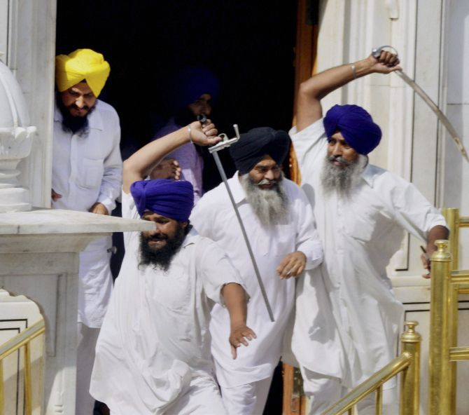 Sikhs brandishing swords during a clash between SGPC and members of a radical Sikh organisation on the occasion 30th anniversary of Operation Bluestar, at Golden Temple Complex in Amritsar