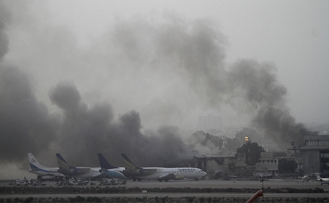 Smoke billows from Jinnah International Airport in Karachi. Gunmen attacked one of Pakistan's biggest airports