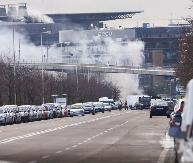 Smoke billows from the airport after a van bomb exploded in the parking area.