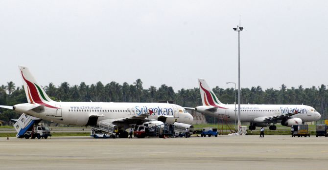 Planes get ready to take off at the Bandaranaike Airport.