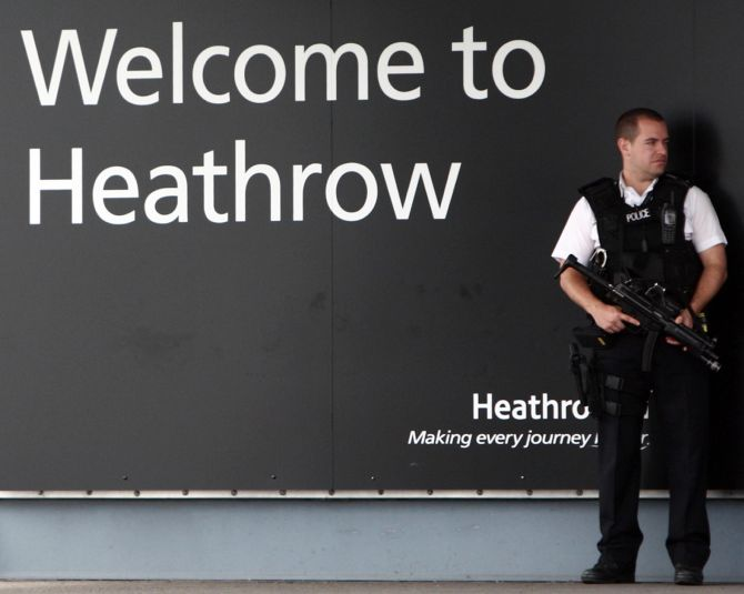 A security guard stands at the entrance of the Heathrow airport in London. Security was beefed up after the terror attack.