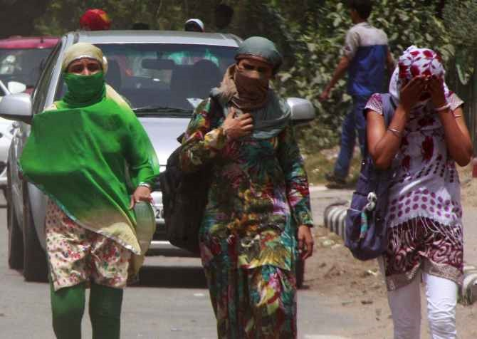 College girls cover their faces to beat the heat in Gurgaon