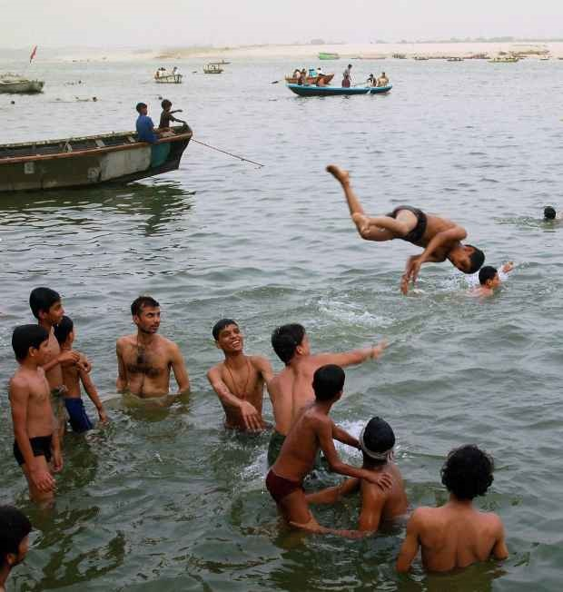 A group of youngsters have fun as they cool off in the Ganga at Varanasi