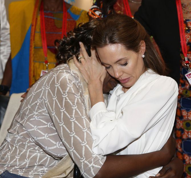 UN High Commissioner for Refugees, Angelina Jolie hugs Neema Namadamu of the Democratic Republic of Congo at the 'End Sexual Violence in Conflict' summit in London.