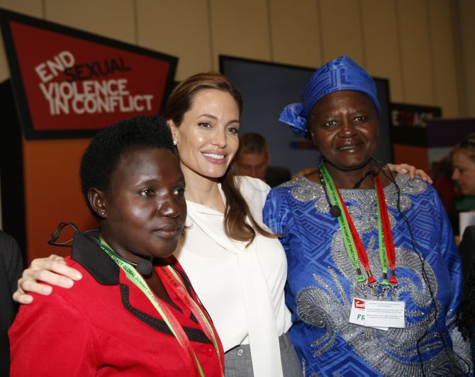 Jolie poses with delegates at the 'End Sexual Violence in Conflict' summit