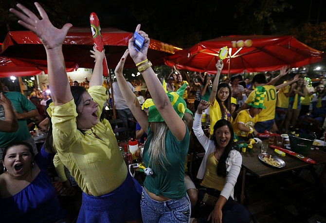 Brazilians celebrate their victory over Croatia in the 2014 World Cup in the town of Itu northwest of Sao Paulo