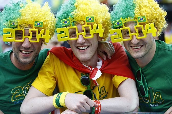 Brazil fans celebrate before the opening match of the 2014 World Cup between Brazil and Croatia in Curitiba