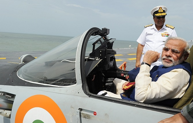 Prime Minister Narendra Modi in a MiG 29K jet on board the INS Vikram