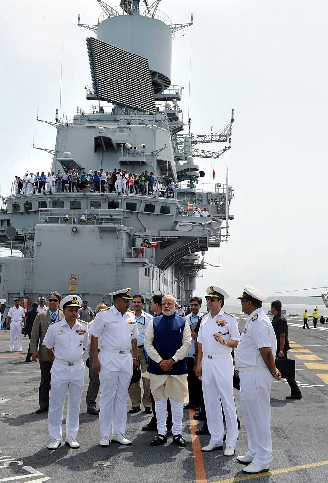 Prime Minister Modi on the deck on the warship with Admiral R K Dhowan and other senior naval officers.