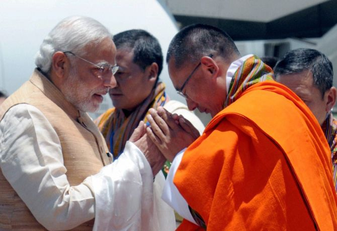 Modi is welcomed by Bhutan PM Tshering Tobgay.