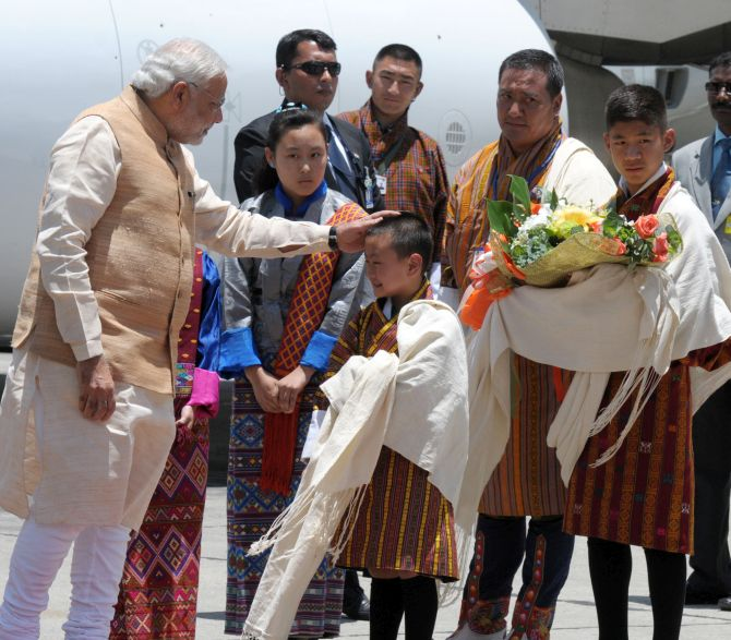 A little boy welcomes PM Modi at Paro airport in Bhutan.