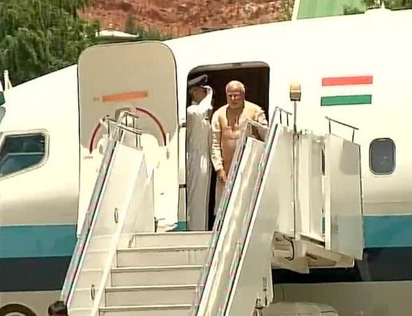 Modi deboards the plane at Paro airport.