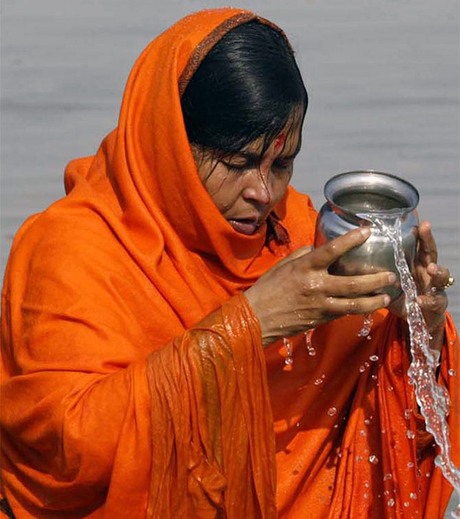 Minister for Water Resources, River Development and Ganga Rejuvenation Uma Bharti performs prayers at the Ganga