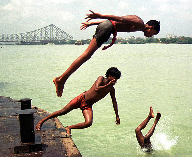 Hoping to seek some respite from the heat, boys take a dip in the Ganga.