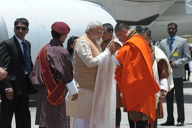 Modi being received by Prime Minister Tshering Tobgay of Bhutan at Paro International Airport