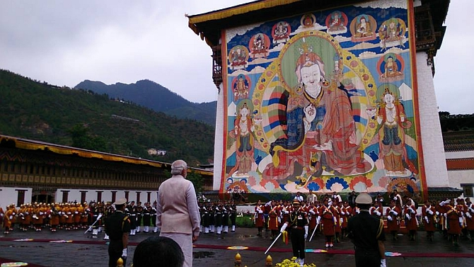 Modi inspects the guard of honour in Thimpu on Sunday