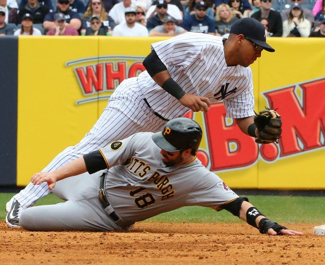 Pittsburgh Pirates second baseman Neil Walker slides into second base during a match with the New York Yankees at the Yankees Stadium.