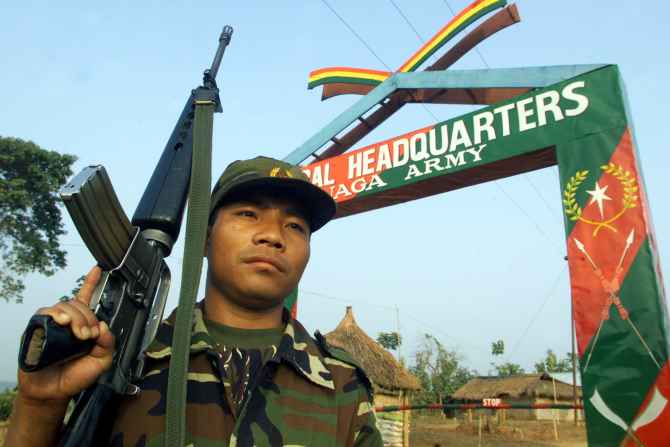 A Naga rebel guards the general headquarters of the NSCN in Hebron, Nagaland
