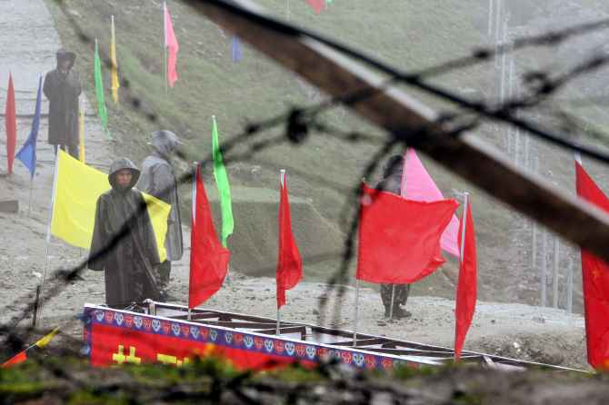 Chinese soldiers guard the Nathu La mountain pass at the Indo-China border in Sikkim.