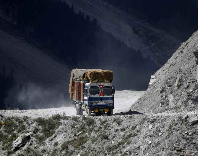 A truck drives on a mountainous road near Zojila in Ladakh