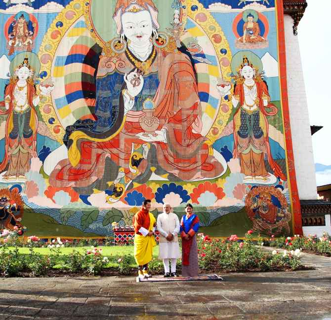 Bhutan King Jigme Khesar Namgyel Wangchuk and Queen Jetsun Pema greet PM Narendra Modi at the Dzong in Paro