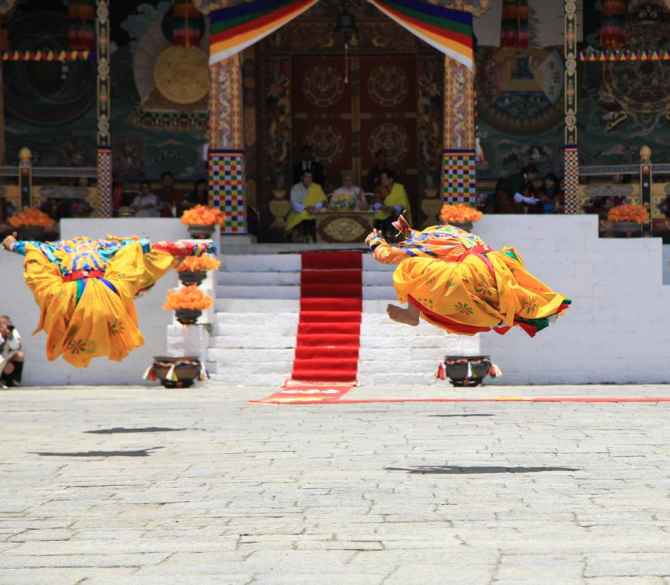 Traditional Bhutanese dancers showcase their skills at a ceremony to welcome PM Narendra Modi on Monday