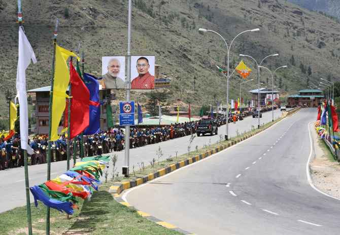 Traditional chhadri and Bhutan and India flags adorn the roads to welcome Narendra Modi to Bhutan.
