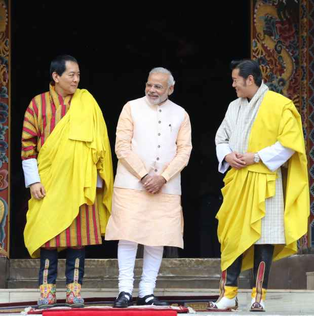 Bhutan's King, Fourth Druk Gyalpo and PM Modi exchange final farewells on Monday.