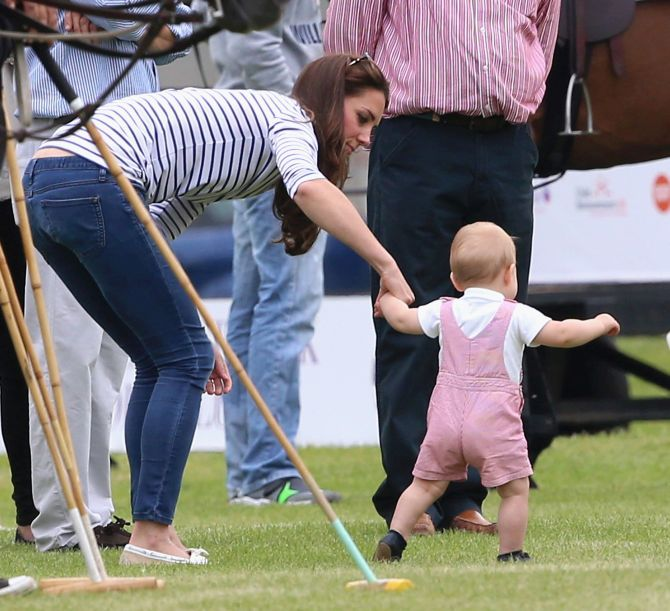 Holding his mother's hand, Prince George takes his first step in public.
