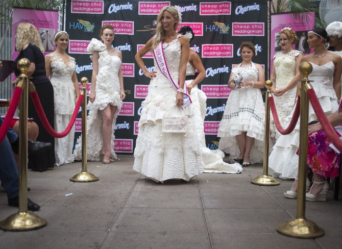 Women display the various wedding dressed made from tissue paper