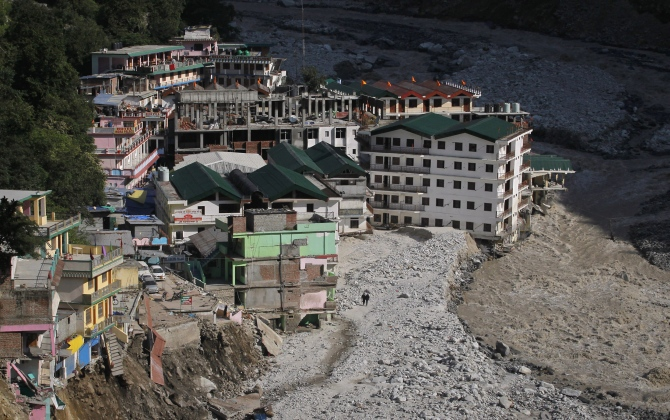 Buildings destroyed during floods are seen next to the Alaknanda river in Govindghat in Uttarakhand in this photograph taken on June 22, 2013.