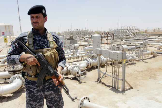 A member from the oil police force stands guard at Zubair oilfield in Basra, Iraq