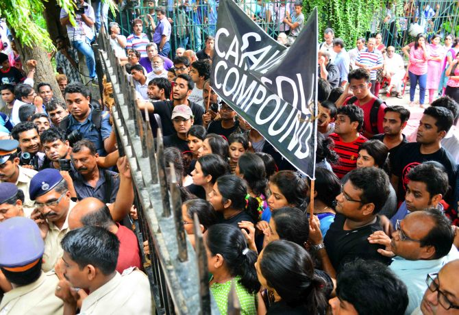 Residents of Campa Cola society form a human barricade not allowing the officials to enter