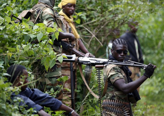 A Seleka fighter holds his machine gun near the town of Kuango, close to the border with Democratic Republic of Congo