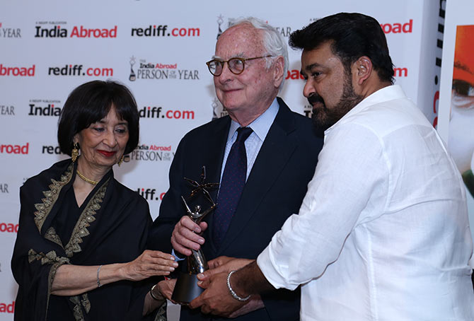James Ivory receiving the award from noted food writer Madhur Jaffrey and Malayalam actor Mohanlal