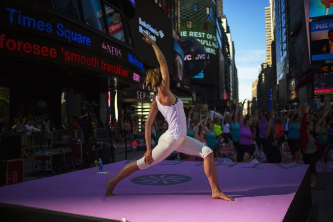 People practice yoga in Times Square as part of a Summer Solstice celebration in New York