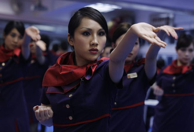 Chinese attendants participate in a kung fu workshop.