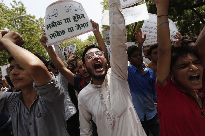 Indians chant protests against the violence and brutality by the ISIS militants in Iraq.