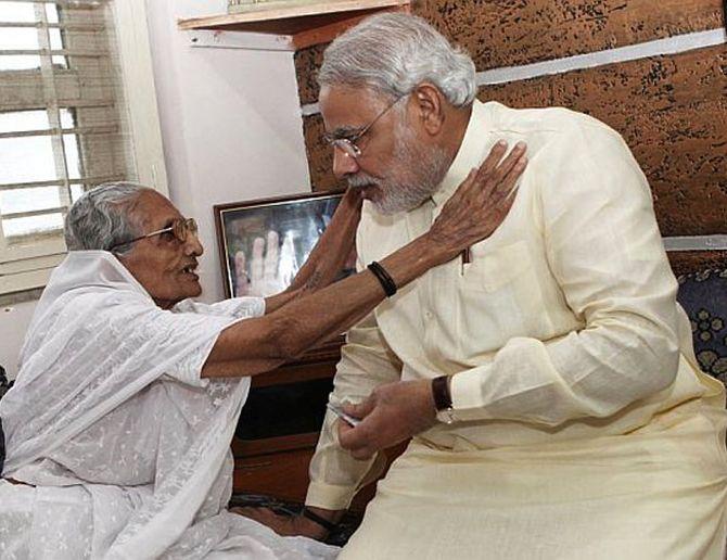 Narendra Modi hugs his mother mother Hiraben