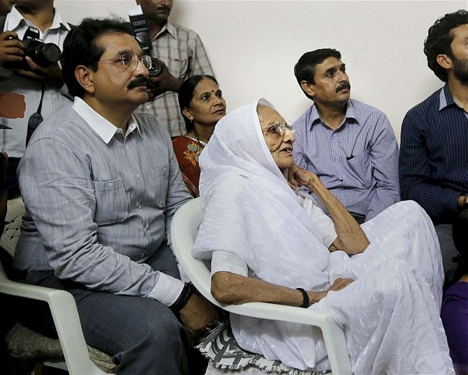 Narendra Modi's mother and family watch on television as he is sworn in as the prime minister