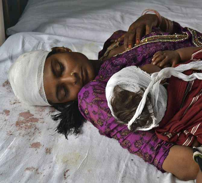 A woman and her child, who were injured in the communal clashes, in a Muzaffarnagar hospital.
